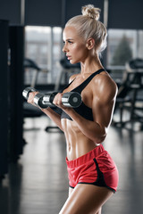 Sexy fitness woman doing exercise in gym. Athletic girl working out © nikolas_jkd