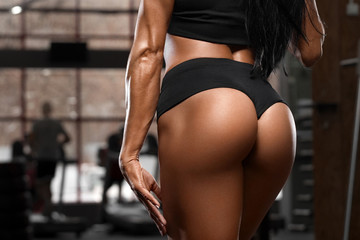 Sexy beautiful butt in thong, sexy ass. Fitness woman in gym