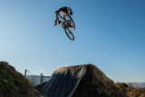 MTB Bike jump over a dirt trail - 242924850