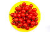 many cherry tomatoes plate red background top view - 242927642