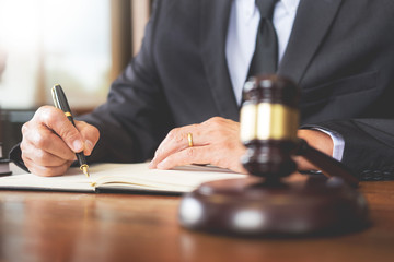 The private office workplace for consultant an young lawyer legislation with gavel and document on wood table.