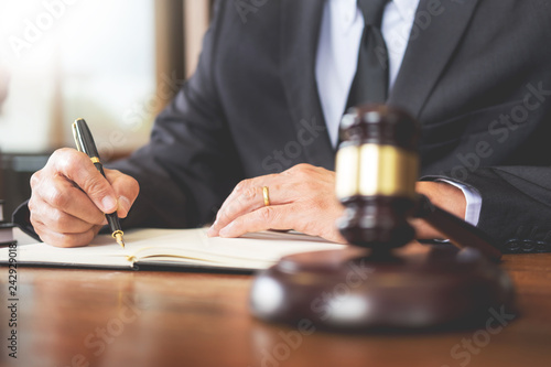The private office workplace for consultant an young lawyer legislation with gavel and document on wood table. - 242929018