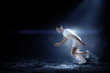 Leinwanddruck Bild - Sportsman running race. Mixed media
