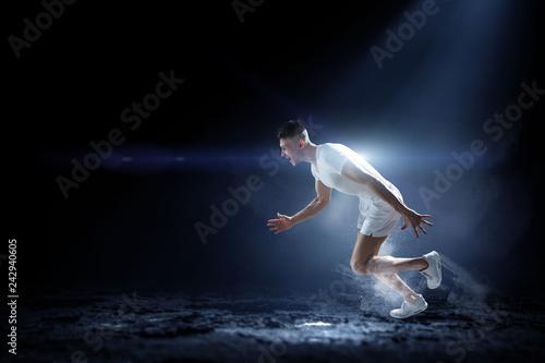 Leinwanddruck Bild Sportsman running race. Mixed media