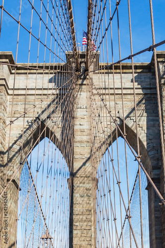obraz PCV Details of the towers with the steel cables of the Brooklyn bridge in New York, United States