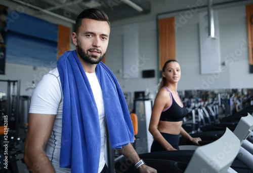 Leinwanddruck Bild close up. an attractive man works in a modern gym