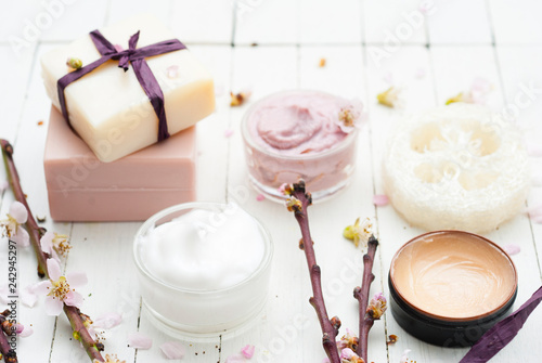 Beauty products and peach flowers