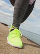 Woman wearing green neon sport shoe