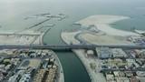 Aerial view Dubai canal footbridge city desert coastline - 242960006
