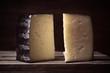 blocks of spanish sheep cheese on wooden board on dark background - 242972018