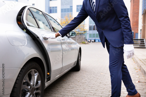 Valet's Hand Opening Car Door