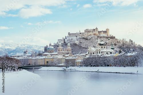 Leinwanddruck Bild Panorama of Salzburg in winter: Snowy historical center, sunshine