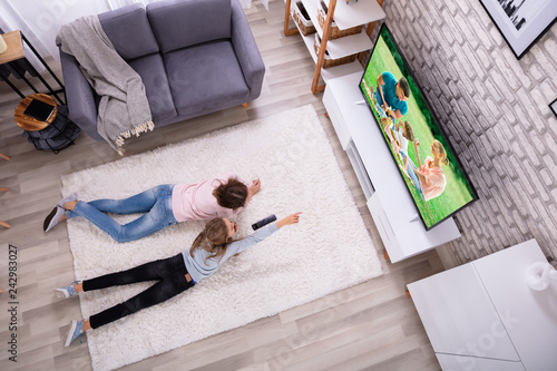 Mother And Daughter Watching Television © Andrey Popov