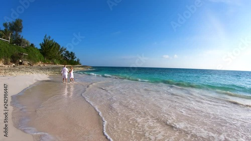 Happy senior couple dancing on beach vacation Bahamas