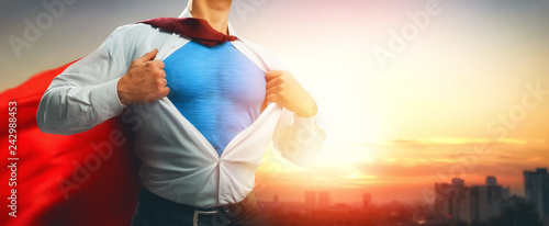 Leinwandbild Motiv superhero businessman looking at city