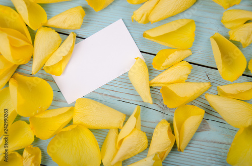 Foto Murales Visiting card in rose petals on rustic wooden background romantic template