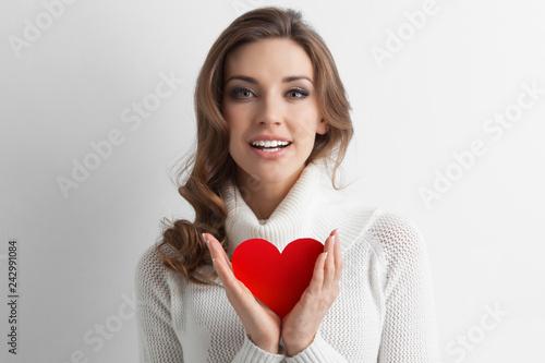 Woman showing paper heart