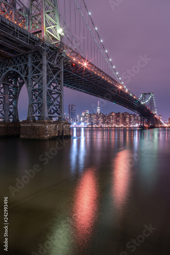 Foto Murales View on Williamsburg bridge at night from east river with long exposure