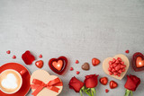 Valentine's day background with coffee cup, heart shape chocolate, candles, rose flowers and gift boxes. - 242997620