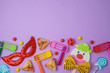Jewish holiday Purim background with cute paper clowns character, hamantaschen cookies and carnival mask.