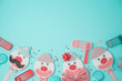 Jewish holiday Purim background with cute paper clowns characters and noisemaker.