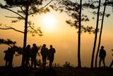 Fototapeta Na ścianę - Image of black silhouette of people watching the sunrise on colorful horizon ( Phu kradueng thailand ) © amenic181
