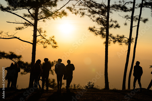 Image of black silhouette of people watching the sunrise on colorful horizon ( Phu kradueng thailand )
