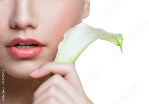 Beautiful female lips with natural color lipgloss and white lily calla flower isolated