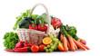 Leinwandbild Motiv Fresh organic fruits and vegetables in wicker basket