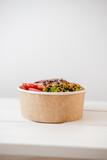 Take away salad in disposable paper bowl - 243007075