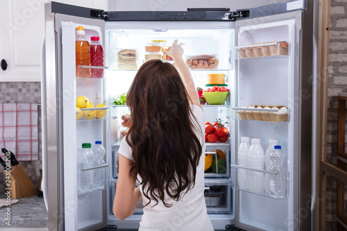 Poster Woman Taking Food From Refrigerator