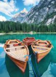 Lago di Braers lake, Dolomite Alps, Italy. Boats on the lake. Landscape in the Dolomite Alps, Italy. Pragser Wildsee - Image