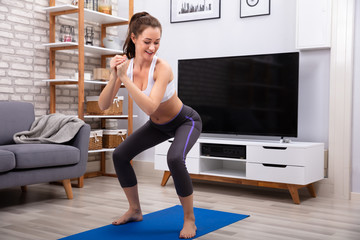 Happy Woman Doing Squat Exercise