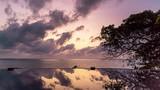Colourful sunrise over pool and sea on a tropical island. 4k time lapse  - 243015416