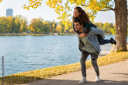Beautiful young couple walking outside in autumn