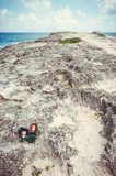 Two little woll puppets standing on a rocky cape in Hawaii, US. - 243020009