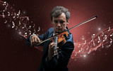 Lonely musical composer with violin and sparkling musical notes around - 243028839