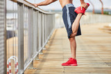 Closeup of man doing stretching exercise outdoors - 243036056