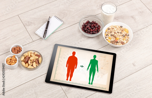Foto Murales Arrangement of healthy Ingredients with a tablet. Dieting concept