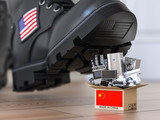 USA China technology war and market conflict.  Economic trade war concept. Cardbox with appliance made in China and american military boot above it. - 243045406