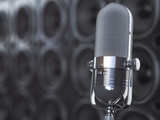 Microphone on black background from  professional loudspeakers and subwoofers. Audio and music concept. - 243045420