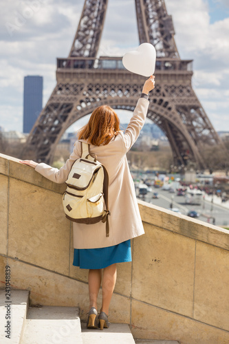 Wall mural girl on the background of the Eiffel Tower