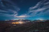 Fototapeta Zachód słońca - Paisaje de un pueblo con las estrellas © Manuel