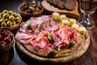 Leinwandbild Motiv Serrano ham platter with variation of appetizers