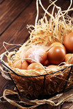 Egg. Fresh farm eggs in basket. Easter egg with feather concept - 243050267