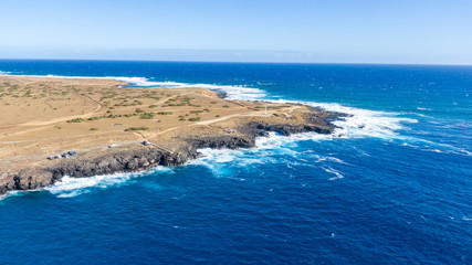 Aerial drone view of Ka Lae, known as South Point, the southernmost point of the Big Island of Hawaii and of the 50 US states. South point is a popular tourist destination with a famous cliff dive.