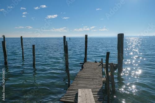 Acrylglas Pier piloni e pontile sul lago di garda a sirmione