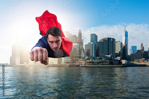 Superhero businessman flying over the city
