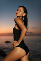 Summer Fashion. Sexy Woman In Black Swimsuit On Sea Coast © puhhha