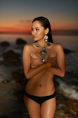 Sexy Woman With Topless Slim Body On Sea Beach At Sunset © puhhha